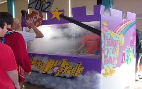 Students participate in booth games for spirit week