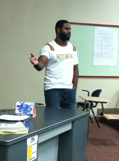 Kaylin Magosin ('14)/ Eastside Editor-in-Chief Green shares his story with students in Lecture Hall 2.