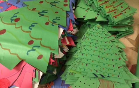 Members dedicate time after school and occasionally at night to create decorations for the holiday party.