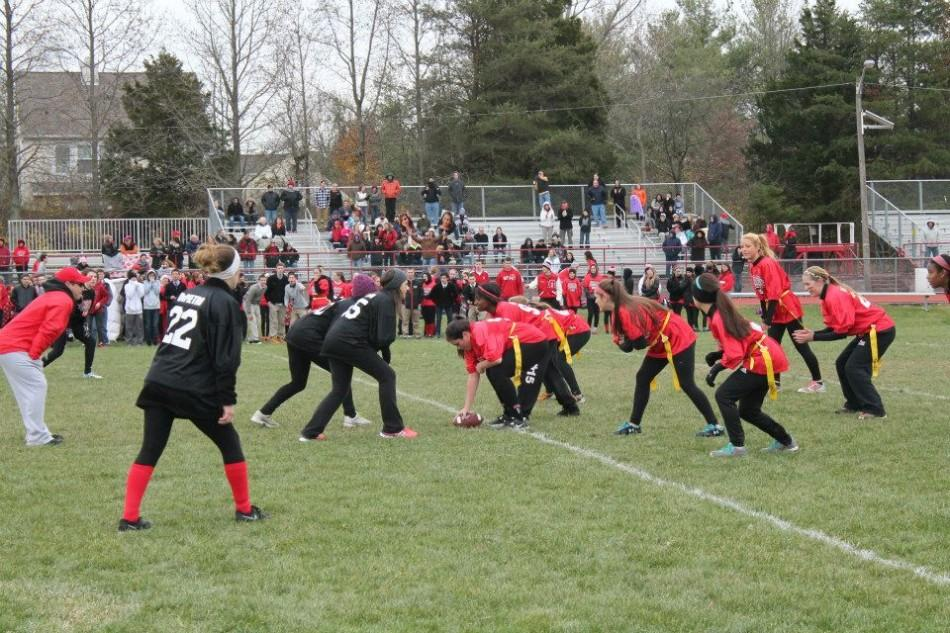 A+scene+from+this+year%E2%80%99s+Powderpuff+Football+game.+The+annual+event+often+attracts+more+spectators+than+other+girls+sporting+events+at+East.+