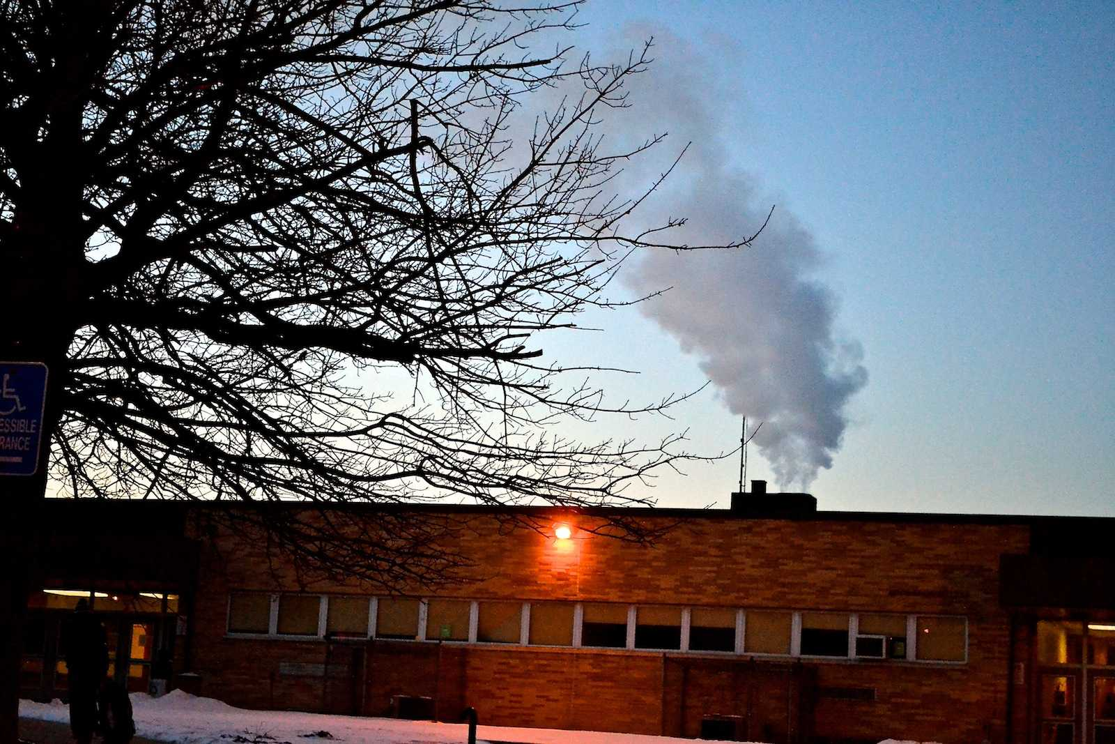 On cold mornings, dark grey smoke, produced by the burning of fossil fuels, can be seen rising above East's roof.