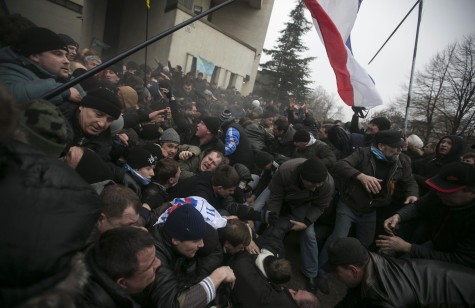 Russian soldiers clash with protesters near the parliament building in Simferopol, Crimea.