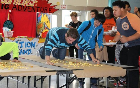 Excitement overflows as students compete in cafeteria games.