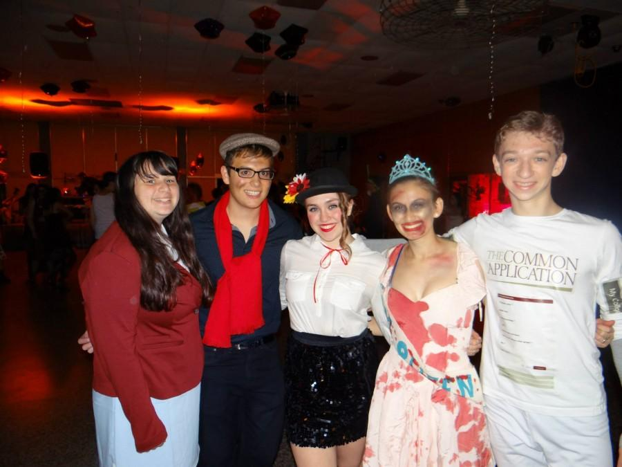 East students dance away the night in their Halloween costumes.