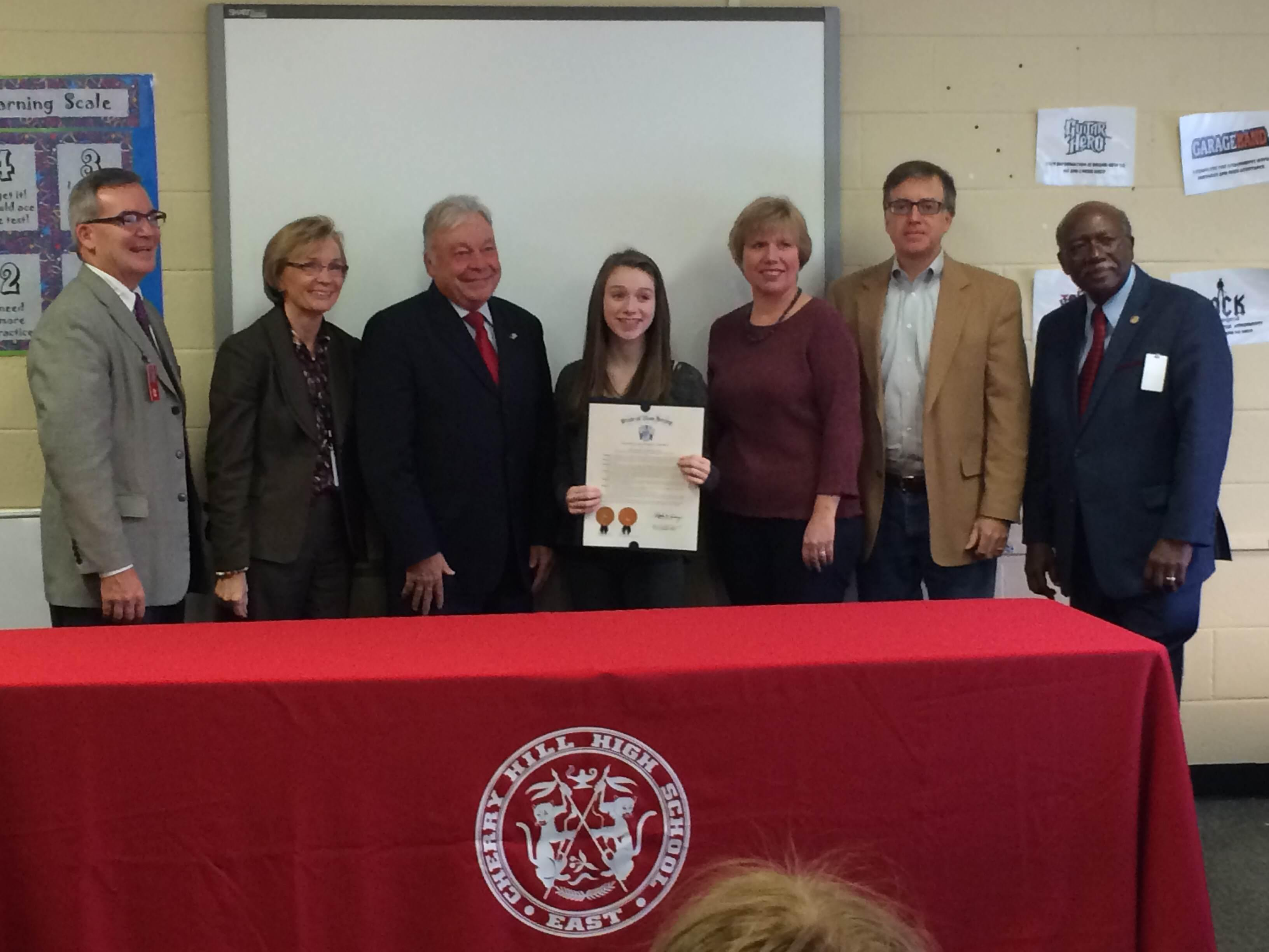 Members of the district congratulate Allison Donahue for her achievements.