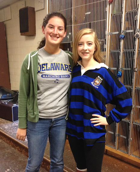 Olivia Marcelli (right) and Madeline Bowne (left) shows school spirit by wearing their college shirts.