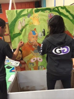 Seniors assiduously work to complete their booth.