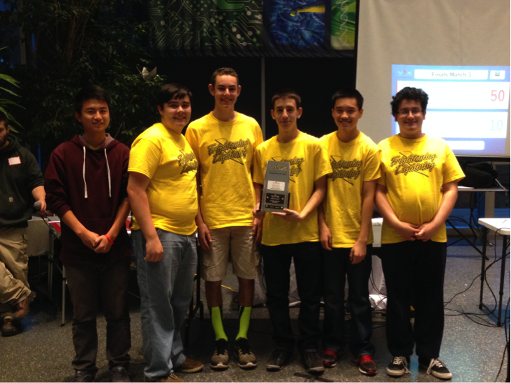 Robotics team members pose with their award.