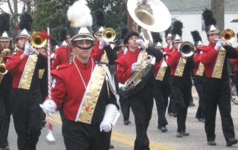 Marching Band with one of its drum majors, Lauren Feldman ('15) at left in the front.
