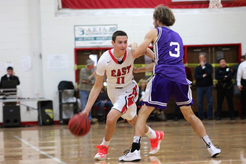 Josh Brown runs fiercely across the court.