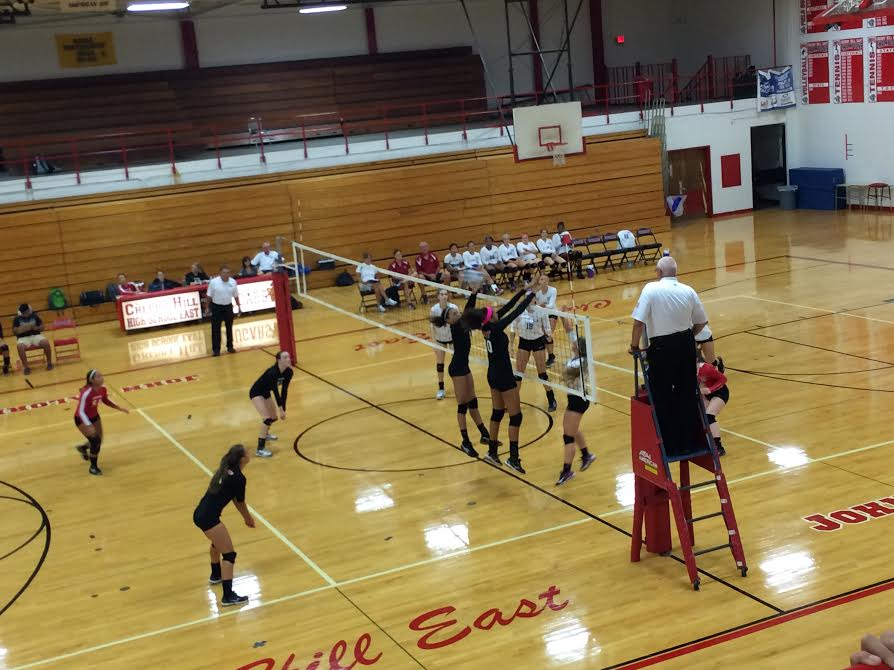 East vs. Washington Township in an intense volleyball game.
