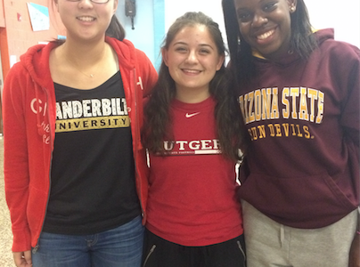 Sarah Jang ('17), Kat Kazantsev ('17) and Bianca Christophe ('16) wear their college gear for spirit week.