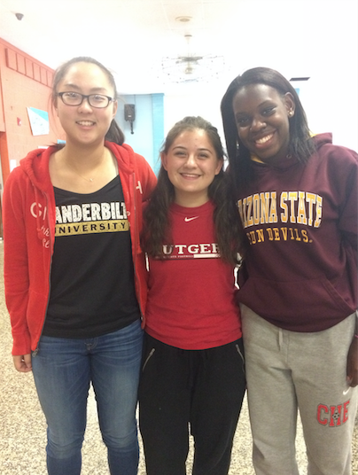 Sarah Jang ('17), Kat Kazantsev ('17) and Bianca Christophe ('16) wear their college gear for spirit week.