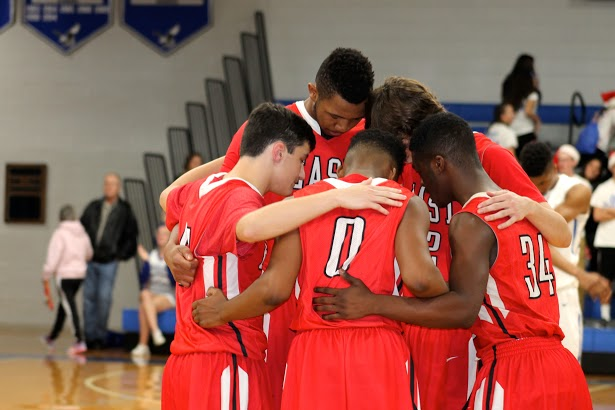 Cherry Hill East basketball team unites to defeat Paul VI.