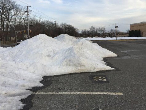 Snow covers the parking lots at Cherry Hill East.