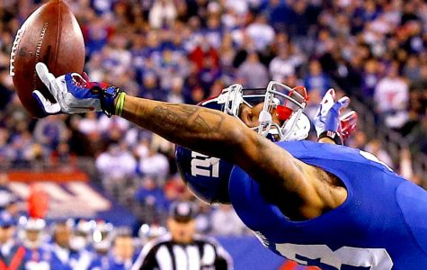 Odell catches the ball shocking the crowd at a New York Giants Game.