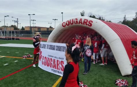 East Cougars get ready to enter the new field.
