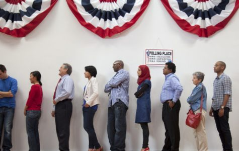 Voters waiting to vote in the polling place