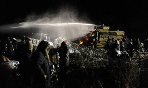 The Army Corps of Engineers does not allow construction workers to build the Dakota Access Pipeline  because it crosses Native American land.
