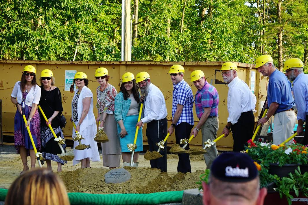 Members of the Chabad community begin the groundbreaking ceremony