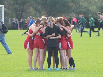 The Girls Cross Country team celebrates victory