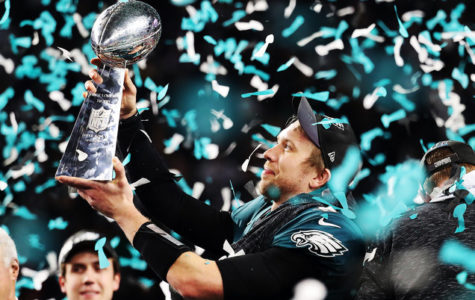 Nick Foles celebrating with the Vince Lombardi trophy after the Eagle's monumental Super Bowl win.