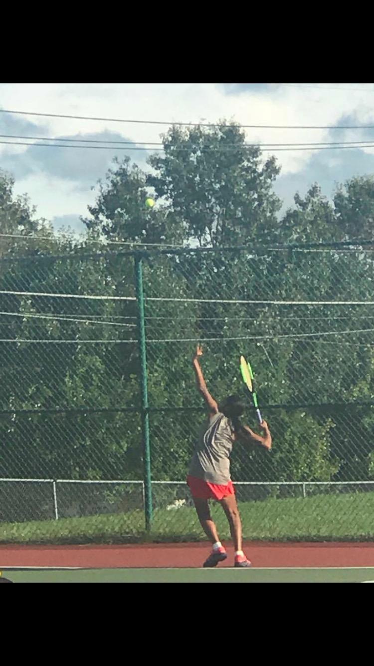 Pallavi Goculdas ('20) practices her form on the tennis court.