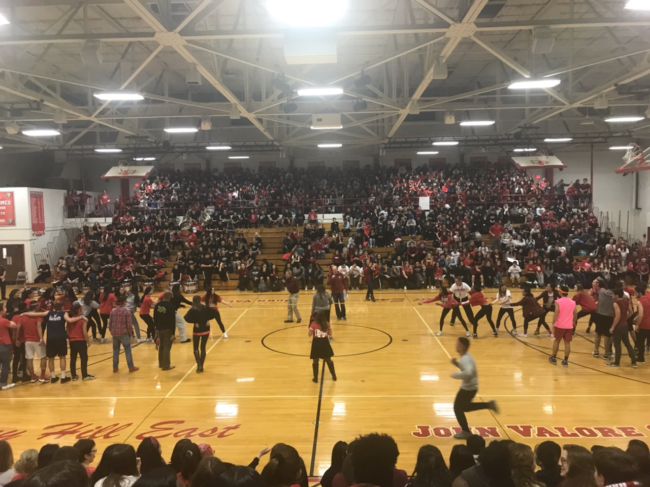 The junior class faces the senior class during the tug of war event during the pep rally.