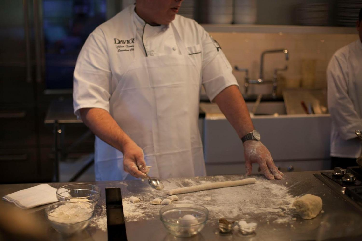 A chef at Davio's prepares gnocchi as part of a traditional Italian dinner.