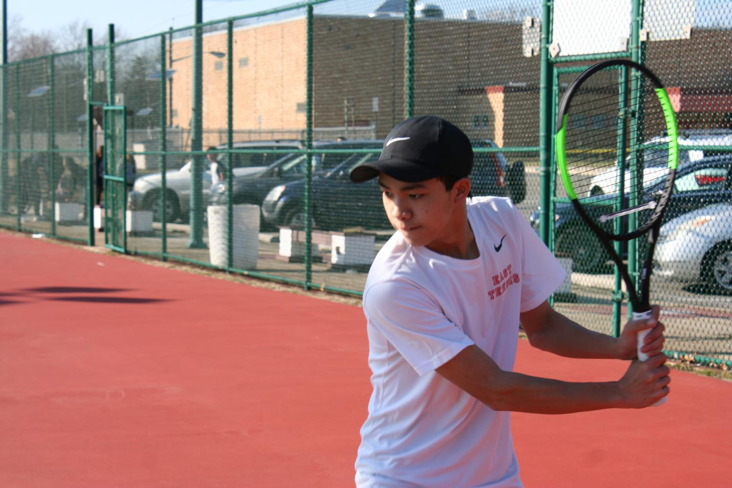 Yu ('19) prepares his stance as he prepares to hit a tennis ball.