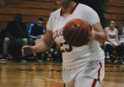 Yaya Villegas ('20) dribbles the ball to the basket.