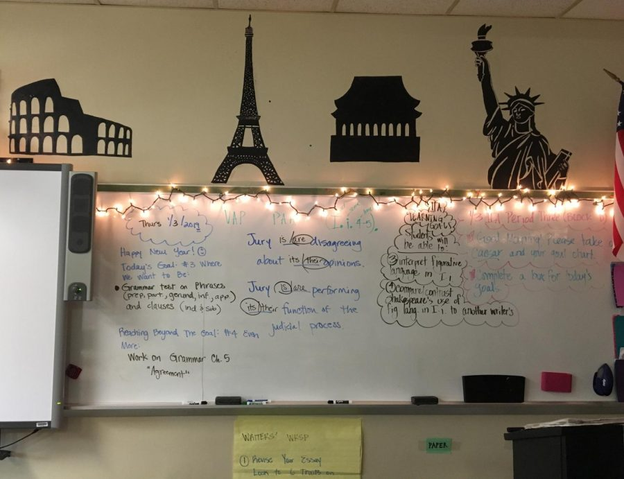 Ms.+Cunningham+decorates+her+room+with+festive+lights++and+student+art.+