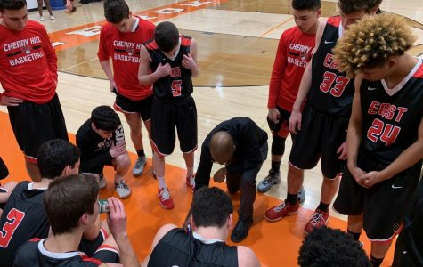 Coach Dave Allen draws up a play for his team.