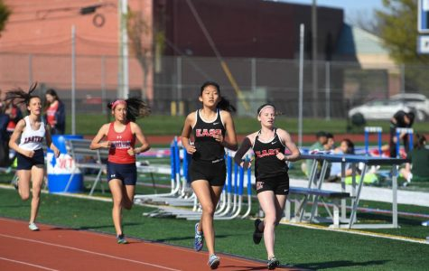 East Girls' Track runners face off in a race.