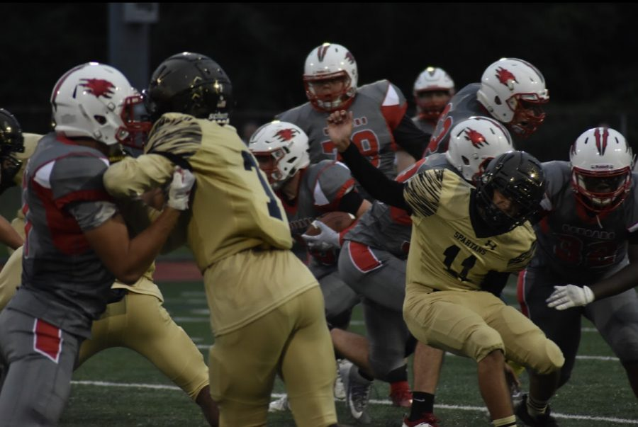 East Cougars' Football Team Suffers a 44-6 Loss to Deptford in the Season Opener