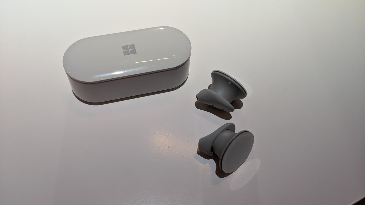 The Surface Earbuds and their carrying case.