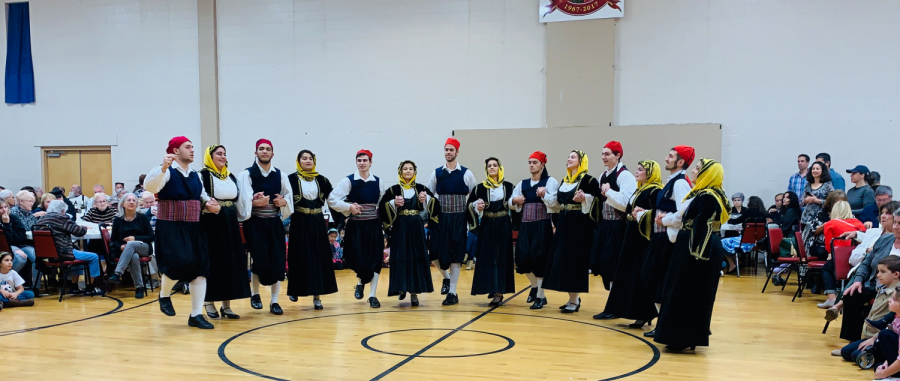 Dancers+perform+a+traditional+Greek+dance+live+with+Greek+music+at+the+Greek+Agora+Festival.