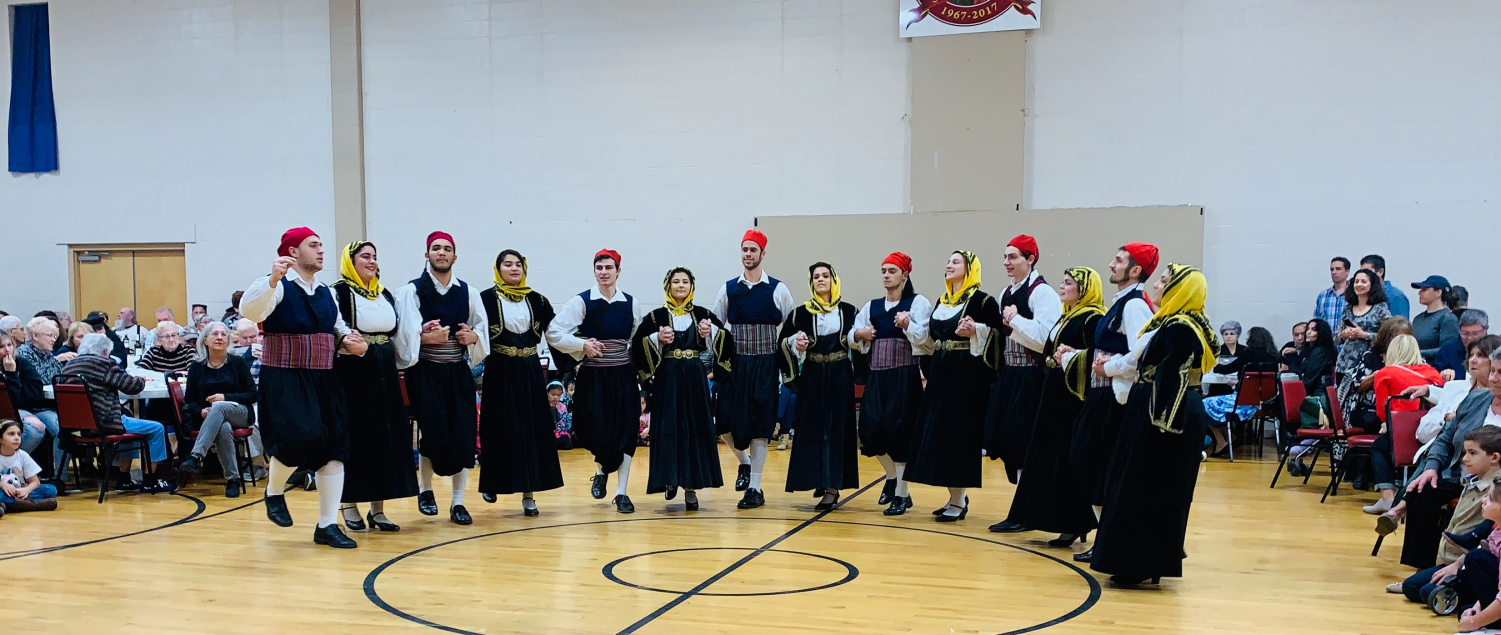 Dancers perform a traditional Greek dance live with Greek music at the Greek Agora Festival.