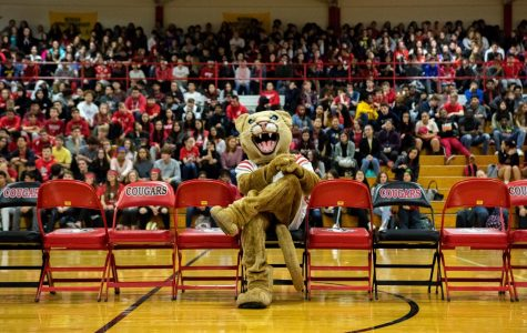 Crimson the Cougar poses at the center of a dispirited crowd.