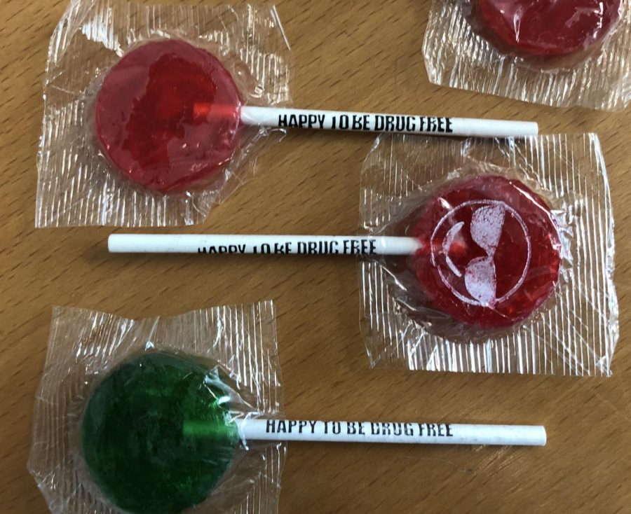 "Lollipops that read ""HAPPY TO BE DRUG FREE"" are distributed to the winning classes."