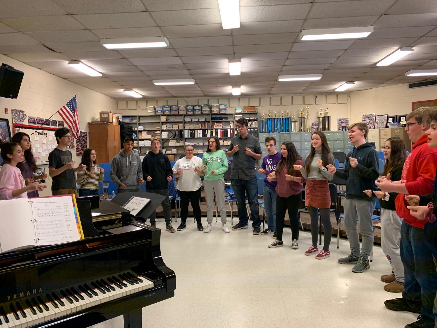 Voce sings Christmas carols in preparation for their upcoming events.