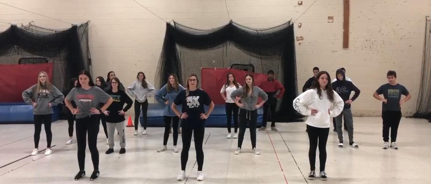 The freshmen class practice their Spirit Week dance.