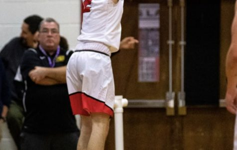Drew Greene ('22) attempts to score another basket.