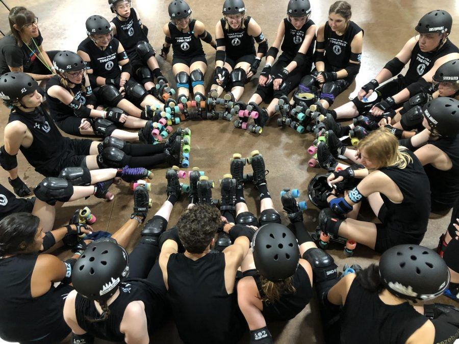 Philly%27s+Roller+Derby+Team+circles+up+before+a+match.