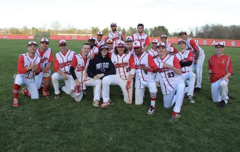 The Cherry Hill East Baseball teams poses for a picture at the end of a game.