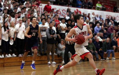 Cherry Hill East's Jake Green ('22) moves the ball during a basketball game between Eastern and Cherry Hill East.