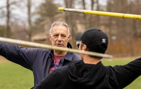 Bramnick coaches Christian Torres ('20) for javelin, the event Bramnick did himself while at East.