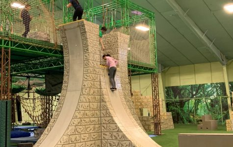 Gym members attempt to climb the famed