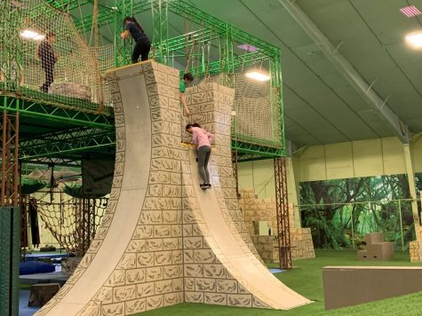 "Gym members attempt to climb the famed ""warped wall"""
