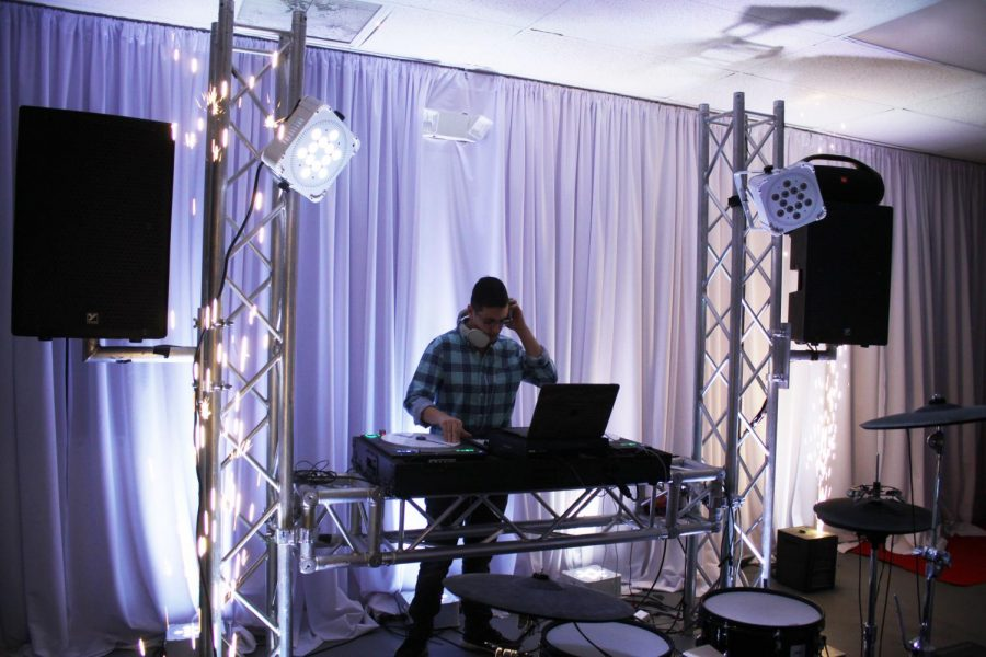 Bloom sets up his equipment for an event he was hired to DJ.